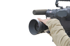 Tv cameraman. A tv cameraman is operating a camera. Picture isolated over a white background royalty free stock photos