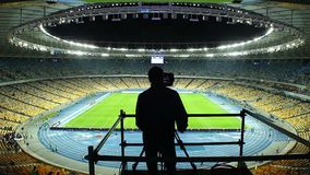 TV cameraman broadcasting football match event stadium game fans. Stock footage stock video footage