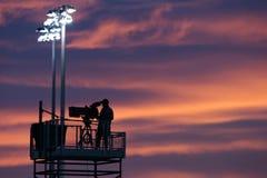 TV-Cameraman At Sunset Stock Foto's