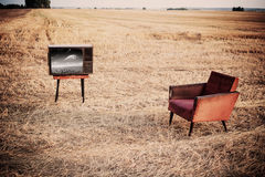 TV and chair outdoor Stock Image