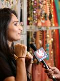 TV channel Reporter interview woman fashion accessories shop owne. R in festive season,as December month see more sale ,on December 11,2017 in Hyderabad,India Stock Photography