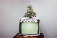 TV, Christmas tree. On the retro background stock images
