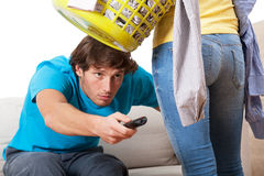 TV instead cleaning Royalty Free Stock Image