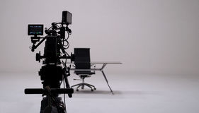 TV commercial recording and movie camera set. TV commercial recording and movie camera set and camera man in big studio Stock Photography