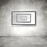 TV on concrete wall Stock Photos