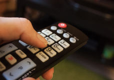 TV-console. In the hand Stock Images