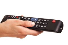 TV console in woman's hand Stock Images