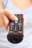 TV console in woman's hand Stock Photo