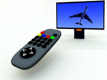 TV Control And TV 11. A image of a television remote control with a travel program on Stock Photo