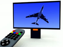 TV Control And TV 12. A image of a television remote control with a travel program on Stock Photography
