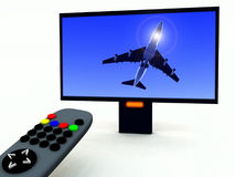 TV Control And TV 18. A image of a television remote control with a travel program on Stock Photo