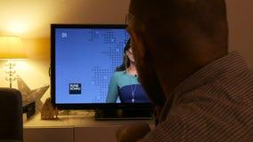 Tv debates on Trump president election on Bayerischer Rundfunk HR Channel Germany. PARIS, FRANCE - NOV 9, 2016: Man watching on German TV - Hessischer Rundfunk stock video footage