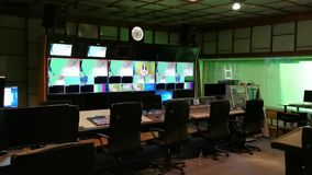 TV directing cab - tv editing boards. Nobody at monitors stock video footage