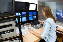TV director at editor. Female TV director at editor in studio Royalty Free Stock Photo