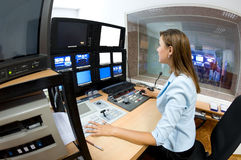 TV director at editor. Female TV director at editor in studio stock photo