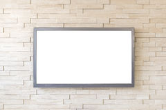 TV display on modern brick wall background with white screen Royalty Free Stock Photos
