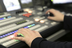 TV editor working with audio video mixer in a television broadcast. Studio desk station stock photography
