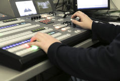 TV editor working with audio video mixer in a television broadca Stock Photos