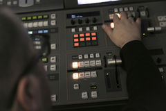 TV editor working with audio video mixer in a television broadca Royalty Free Stock Images