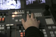 TV editor working with audio video mixer in a television broadca Royalty Free Stock Photography