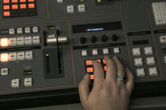 TV editor working with audio video mixer in a television broadca Stock Photo
