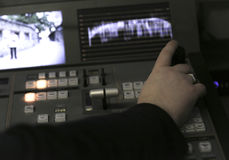 TV editor working with audio video mixer in a television broadca Stock Images