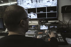 TV editor working with audio video mixer in a television broadca Stock Image