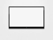 TV en blanco en la pared Imagen de archivo libre de regalías