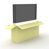 TV en una caja de embalaje. Fotografía de archivo