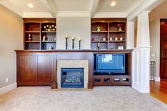 TV entertainment center wood build in. TV and entertainment center with white wood ceiling in a luxury room Stock Photo