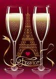 Två exponeringsglas av champagne på bakgrundskonturn av Eiffeltorn i Paris Frankrike inskrift på bandet Royaltyfri Fotografi