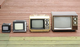 TV Family. On an old deck stock photography