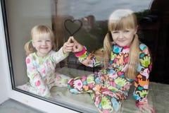 Två flickor Fotografering för Bildbyråer