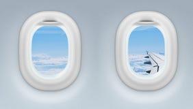 Två flygplan- eller strålfönster Fotografering för Bildbyråer