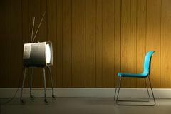 TV Glow. Retro television set casting an eerie glow on an empty chair Royalty Free Stock Images