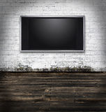 Tv in a grungy room Stock Images