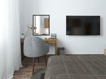 TV hanging on the wall and desk in the bedroom in the loft. Stock Image