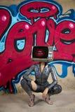 Tv head woman and graffiti wall stock photography