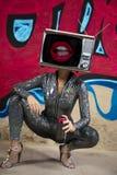 Tv head woman and graffiti wall royalty free stock photo