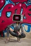 Tv head woman and graffiti wall royalty free stock images