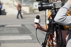 TV interview. Covering an event with a video camera Stock Images