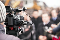 TV interview. Covering an event with a video camera Stock Photo