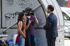 TV interview. BARCELONA, SPAIN - OCTOBER 7, 2014: Some journalists conducted an interview with a video camera, a man in one of the streets of their city Stock Photo