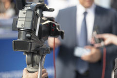 TV interview. Covering an event with a video camera Royalty Free Stock Images