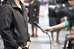 TV interview. Media interview with the microphone Stock Photo