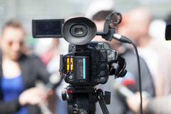 TV interview. News conference. Filming an event with a video camera. TV broadcasting Royalty Free Stock Image