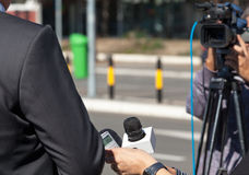 TV interview. News conference. Media interview with businessman, politician or spokesman Stock Images