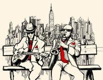 Två jazzmän som spelar i New York Royaltyfri Bild