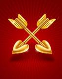 Två korsade guldpilar av cupid med hjärtor Royaltyfri Fotografi