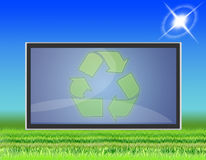 TV LCD flat screen (05). Lawn with LCD TV that transmits symbols of ecology Royalty Free Stock Image